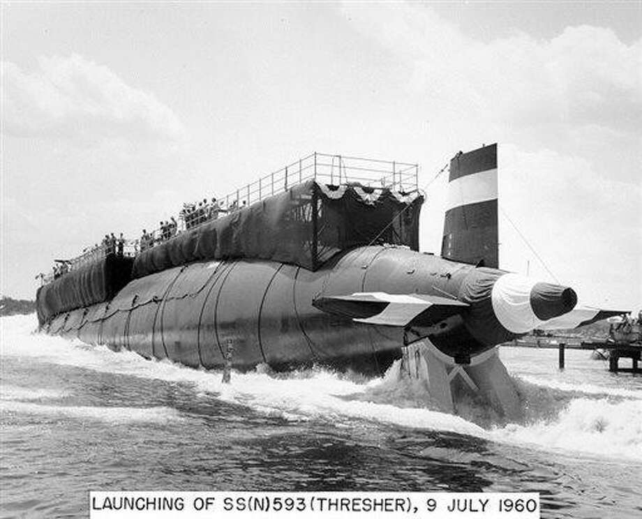 FILE- In this July 9, 1960 handout file photo provided by the U.S. Navy, the nuclear-powered submarine USS Thresher is launched at the Portsmouth Naval Shipyard in Kittery, Maine. Fifty years ago 129 men lost their lives when the sub sank during deep-dive testing off Cape Cod. The deadliest submarine disaster in U.S. history delivered a blow to national pride during the Cold War and became the impetus for safety improvements. (AP Photo/U.S. Navy, file) Photo: AP / Portsmouth Naval Shipyard