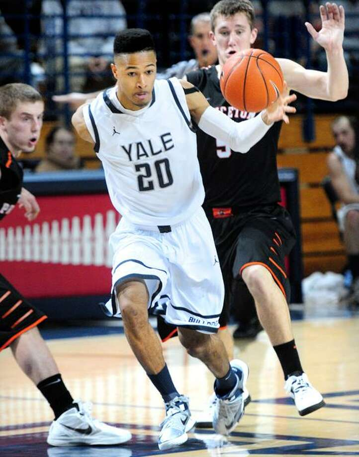 Javier Duren (center) of Yale pushes the ball up the court against Princeton in the first half on 3/8/2013.Photo by Arnold Gold/New Haven Register   AG0486D