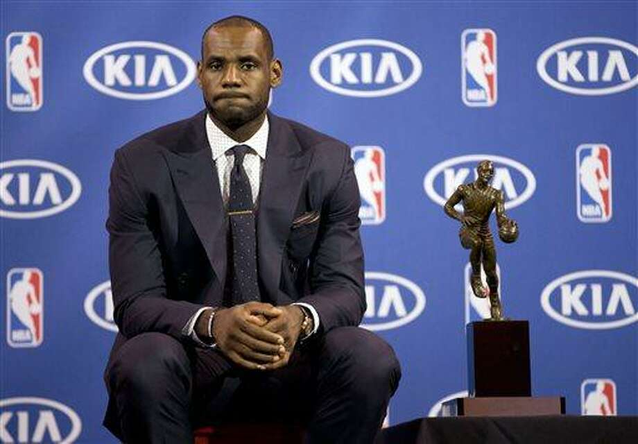 Miami Heat's LeBron James poses for photos during an NBA basketball news conference, Sunday, May, 5, 2013, in Miami. James was formally announced as having won his fourth Most Valuable Player award Sunday. (AP Photo/J Pat Carter) Photo: AP / AP