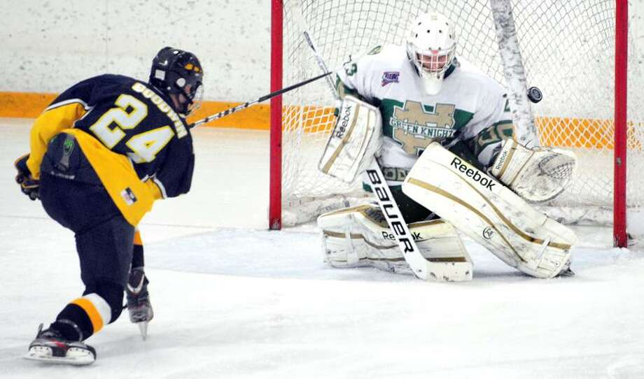 Notre Dame - West Haven goalie Luciano Amatruda (right) blocks a shot from Tristan Goodwin (left) of East Haven in the second period  at Bennett Rink in West Haven on 3/6/2013.Photo by Arnold Gold/New Haven Register