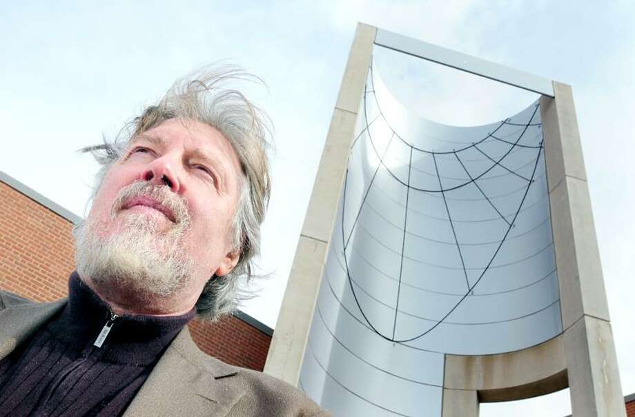 A recent photo of Southern Connecticut State University anthropology professor Joseph Manzella in front of a sundial at Engleman Hall. He is working on a book about alternative spiritual communities around the world. Arnold Gold/Register