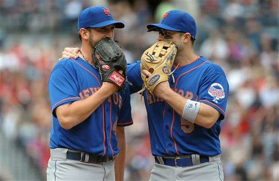 New York Mets starting pitcher Jonathon Niese, left, and third baseman David Wright (5) talk after Niese loaded the bases against the Atlanta Braves during the third inning of a baseball game at Turner Field, Sunday, May 5, 2013, in Atlanta. (AP Photo/David Tulis) Photo: AP / FR170493 AP