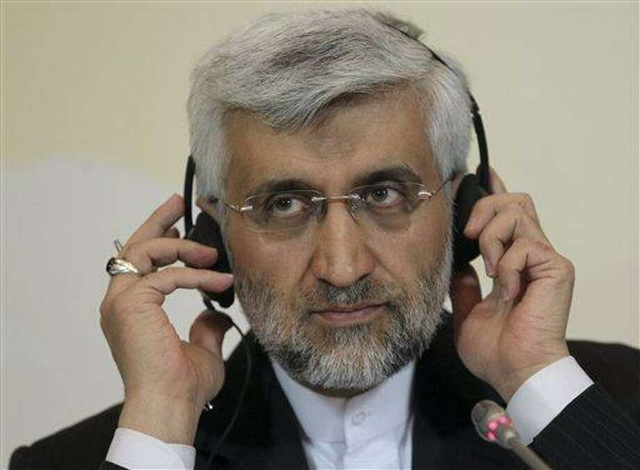 """Secretary of Iran's Supreme National Security Council, Saeed Jalili listens to a question during his news conference after the high-level talks between world powers and Iranian officials in Almaty, Kazakhstan, Saturday, April 6, 2013. Iran and six world powers failed to reach agreement Saturday on a common approach to reducing fears that Tehran might misuse its nuclear technology to make weapons, with the EU's foreign policy chief declaring that the to sides """"remain far apart on substance."""" (AP Photo/Pavel Mikheyev) Photo: AP / AP"""