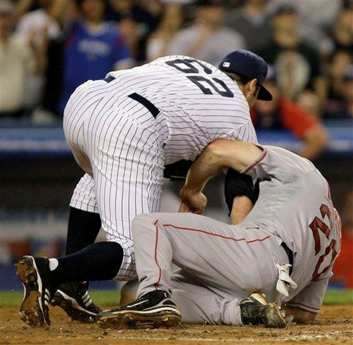 Boston Red Sox's Kevin Youkilis, right, gets tangled up with New York Yankees pitcher Joba Chamberlain as he scores on Chamberlain's fifth-inning wild pitch in their baseball game at Yankee Stadium in New York, Sunday, July 6, 2008. (AP Photo/Kathy Willens)