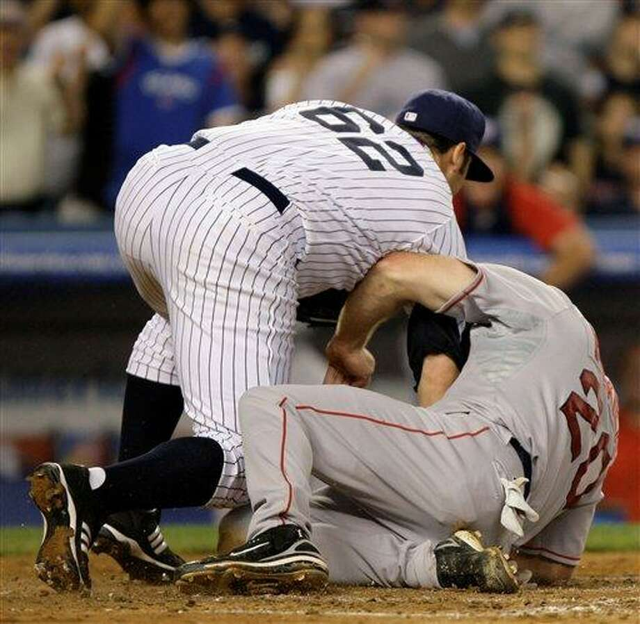 Boston Red Sox's Kevin Youkilis, right, gets tangled up with New York Yankees pitcher Joba Chamberlain as he scores on Chamberlain's fifth-inning wild pitch in their baseball game at Yankee Stadium in New York, Sunday, July 6, 2008. (AP Photo/Kathy Willens) Photo: ASSOCIATED PRESS / AP2008