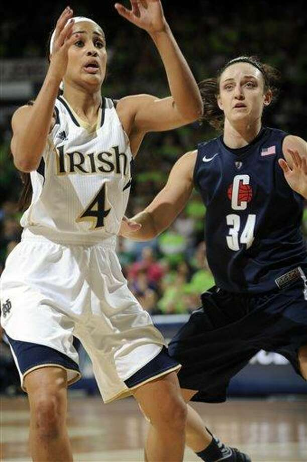 Notre Dame guard Skylar Diggins, left, calls for a pass as Connecticut guard Kelly Faris defends in a college basketball game Monday March 4, 2013 in South Bend, Ind. (AP Photo/Joe Raymond) Photo: ASSOCIATED PRESS / AP2013