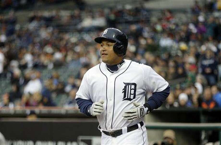 Detroit Tigers third baseman Miguel Cabrera walks back to the dugout after scoring in the eighth inning of a baseball game against the New York Yankees in Detroit, Saturday, April 6, 2013. (AP Photo/Carlos Osorio) Photo: ASSOCIATED PRESS / AP2013