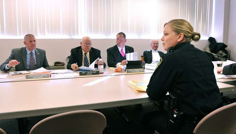 Middletown--Branford police Sgt. Kris Hormuth testifies during a pistol permit hearing in front of the Board of Firearms Permit Examiners at the Department of Emergency Services and Public Protection, Hormuth was testifying on behalf of Branford on the status of an applicant (not shown in photo) who had not provided the town with the proper requirements asked for in the application.  Photo-Peter Casolino 1/24/13