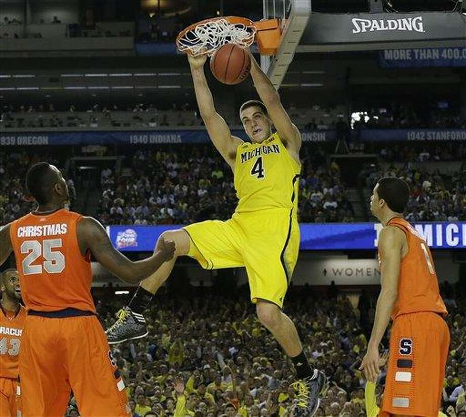 Michigan's Mitch McGary dunks the ball against Syracuse during the second half of the NCAA Final Four tournament college basketball semifinal game Saturday, April 6, 2013, in Atlanta. (AP Photo/Charlie Neibergall) Photo: AP / AP