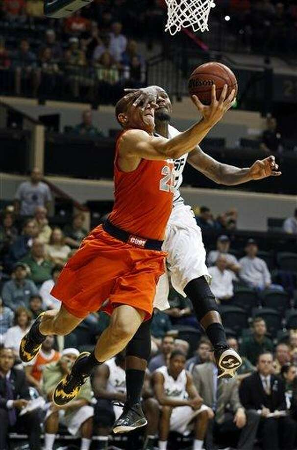Syracuse's Brandon Triche, left, is fouled by South Florida's Toarlyn Fitzpatrick during the first half of an NCAA college basketball game Sunday, Jan. 6, 2013, in Tampa, Fla. (AP Photo/Mike Carlson) Photo: AP / FR155492 AP