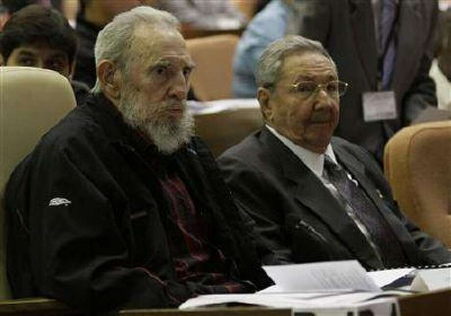 Former Cuban leader Fidel Castro (L) attends the opening session of the National Assembly of the People's Power beside his brother, Cuban President Raul Castro, in Havana February 24. (Reuters/Ismael Francisco/Courtesy of Cubadebate/Handout)