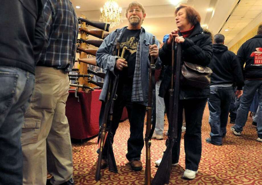 Thomas Palm, of Clinton, Conn., left, and his sister Barbara Roberts of Guilford, Conn. came to theThe East Coast Fine Arms Show Saturday, January 5, 2013 at the Stamford Plaza Conference Center in Stamford, Conn. to sell their antique and replica antique firearms to dealers. The gun show was  hosted by the Westchester Collectors of Connecticut. Photo by Peter Hvizdak / New Haven Register. Photo: New Haven Register / ©Peter Hvizdak /  New Haven Register