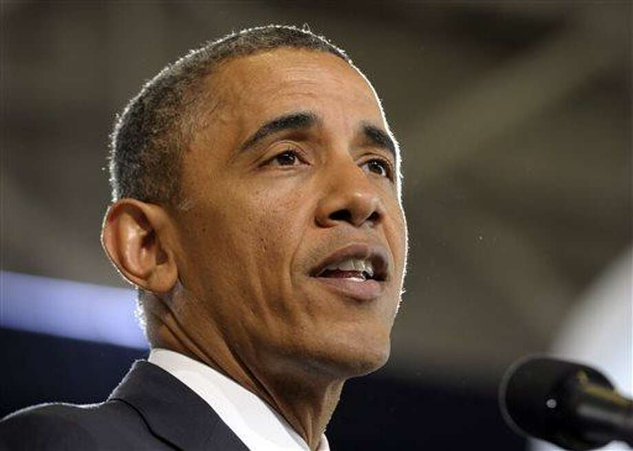 AP File Photo: Barack Obama will propose a new budget which aims to reduce the federal deficit by $1.8 trillion over 10 years. A main component of this budget includes cuts to Social Security. (AP Photo/Susan Walsh) Photo: AP / AP
