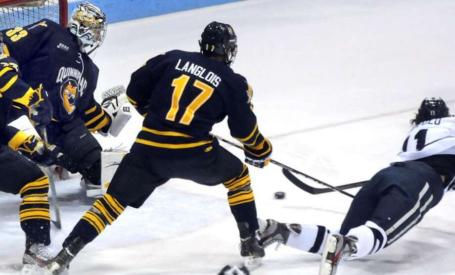 Quinnipiac at Yale, men's hockey, Ingalls Rink. Yale's first goal against QU by Trent Ruffolo right. QU's goalie Eric Hartzell left and Jeremy Langlois center. Mara Lavitt/New Haven Register2/2/13