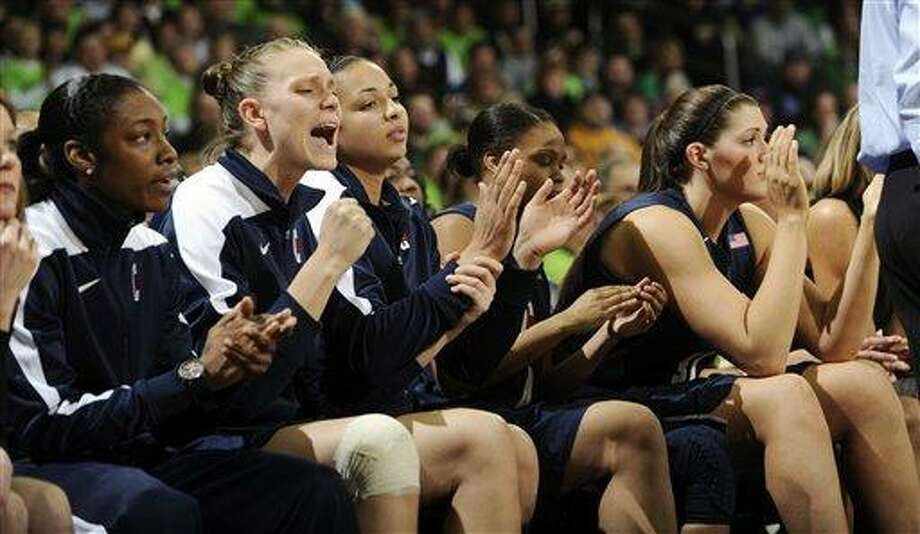 The Connecticut bench reacts to a play in the third overtime of an NCAA college basketball game against Notre Dame, Monday, March 4, 2013, in South Bend, Ind. Notre Dame won 96-87. (AP Photo/Joe Raymond) Photo: AP / FR25092 AP