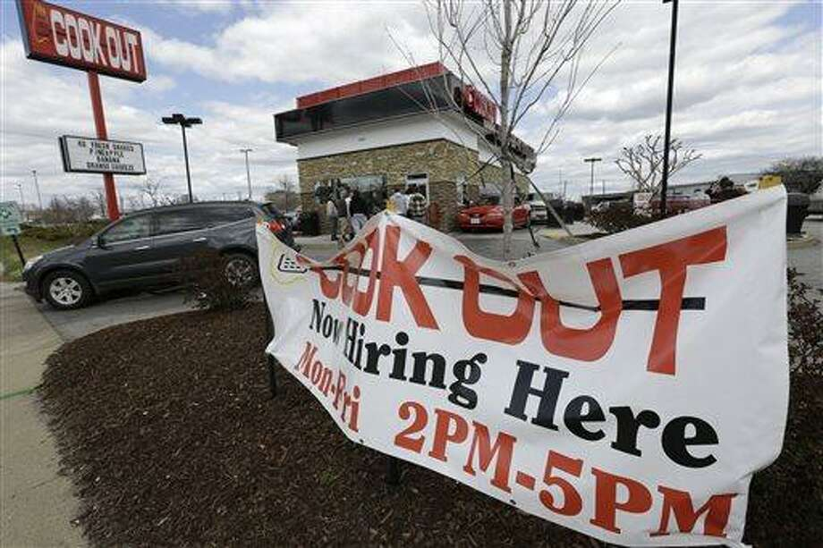 This Friday, March 29, 2013, photo, shows a help wanted sign in front of a restaurant in Richmond, Va. The U.S. economy has enjoyed a four-month stretch of robust job gains, and on Friday, April 5, 2013, the government will signal whether that trend endured into March (AP Photo/Steve Helber) Photo: AP / AP