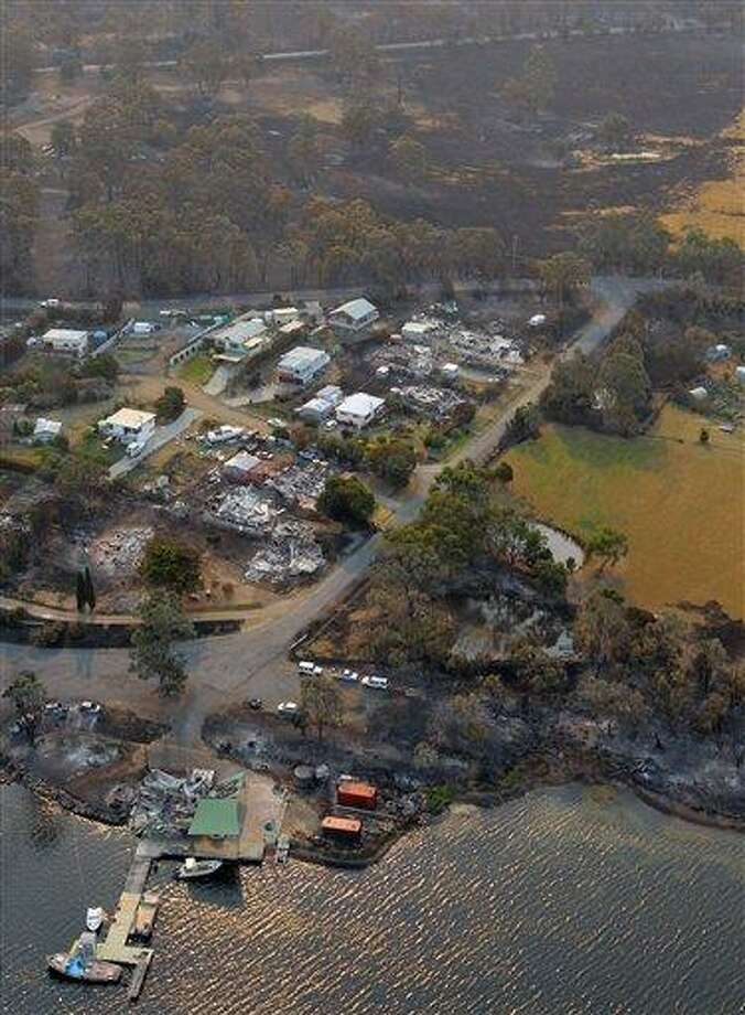 This aerial photo shows a view of Boomer Bay after wildfires raged across southern Australia, on Saturday, Jan. 5, 2013.   Australian officials battled a series of wildfires amid scorching temperatures across the country on Saturday, with one blaze destroying dozens of homes in the island state of Tasmania. (AP Photo/Chris Kidd, Pool) Photo: AP / Pool Nationwide News