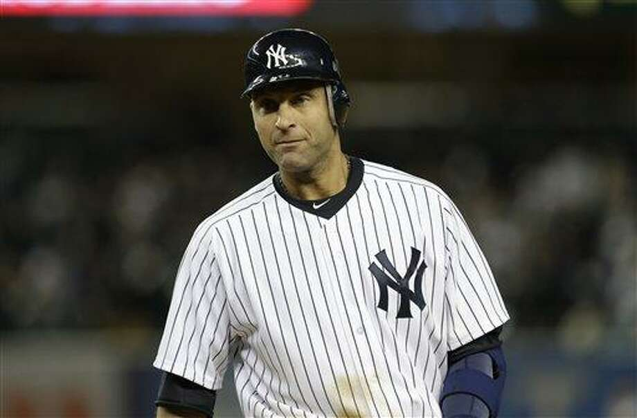 New York Yankees' Derek Jeter walks to the dugout during Game 1 of the American League championship series against the Detroit Tigers Sunday, Oct. 14, 2012, in New York. (AP Photo/Paul Sancya ) Photo: ASSOCIATED PRESS / AP2012