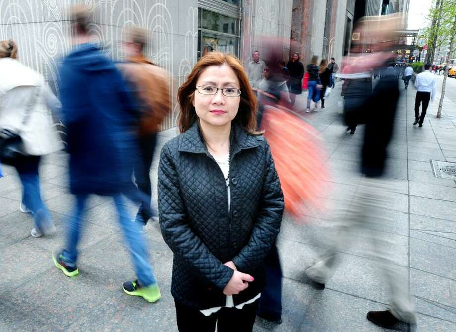 Shandra Woworuntu, a sex trafficking survivor and advocate for victims, is photographed on Park Ave. in New York City on 4/22/2013.Photo by Arnold Gold/New Haven Register   AG0494A