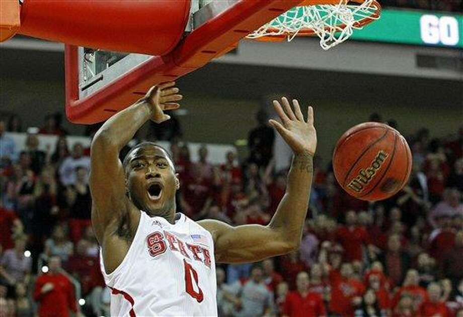 North Carolina State's Rodney Purvis (0) celebrates a slam during the first half of an NCAA college basketball game against Duke in Raleigh, N.C., Saturday, Jan. 12, 2013. (AP Photo/Karl B DeBlaker) Photo: ASSOCIATED PRESS / AP2013