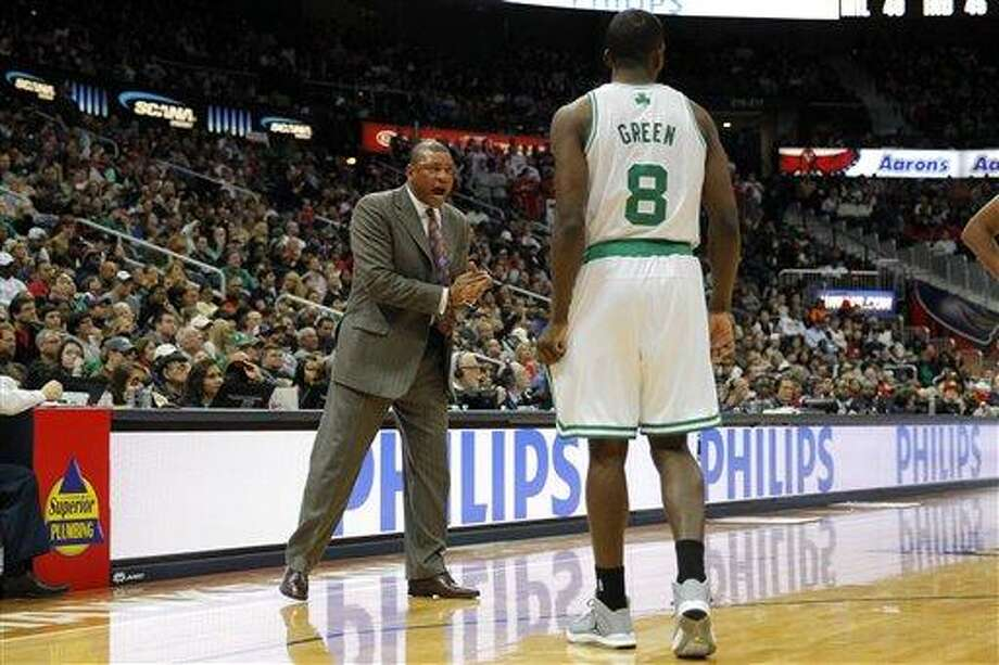 Boston Celtics head coach Doc Rivers, left, cheers power forward Jeff Green (8) in first-half action of an NBA basketball game against the Atlanta Hawks, Saturday, Jan. 5, 2013, in Atlanta. (AP Photo/Todd Kirkland) Photo: AP / FR170762 AP