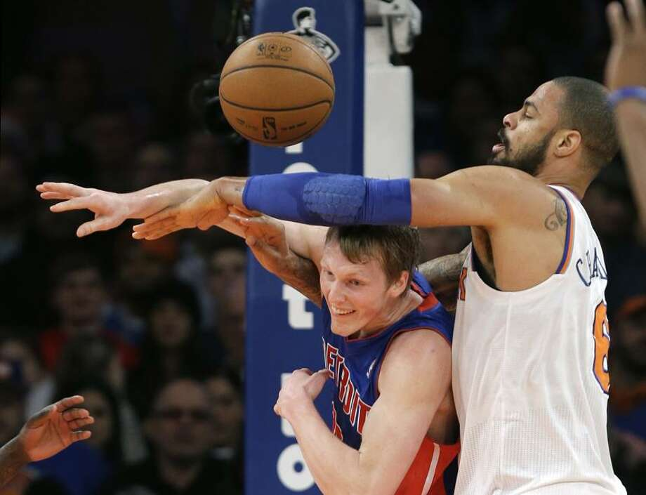 Detroit Pistons guard Kyle Singler, left, gets tangled up with New York Knicks center Tyson Chandler (6) the first half of an NBA basketball game at Madison Square Garden in New York, Monday, Feb. 4, 2013.  (AP Photo/Kathy Willens) Photo: AP / AP