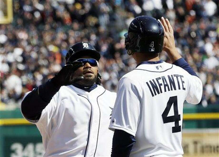 Detroit Tigers' Prince Fielder is greeted by teammate Omar Infante after hitting his three-run home run during the fifth inning of a baseball game against the New York Yankees in Detroit, Friday, April 5, 2013. (AP Photo/Carlos Osorio) Photo: AP / AP