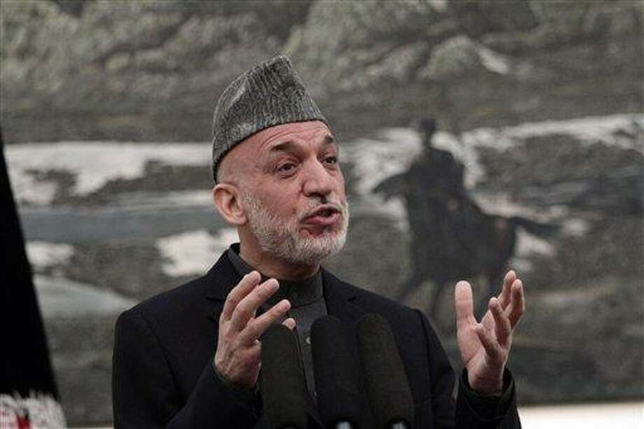 Afghan President Hamid Karzai speaks during a news conference in Kabul, Afghanistan, Saturday, May 4, 2013. Karzai says the director of the CIA assured him that regular funding his government receives from the agency will not be cut off. He says Afghanistan has been receiving such funding for more than 10 years and expressed hope at a Saturday news conference that it will not stop.(AP Photo/Rahmat Gul) Photo: AP / AP