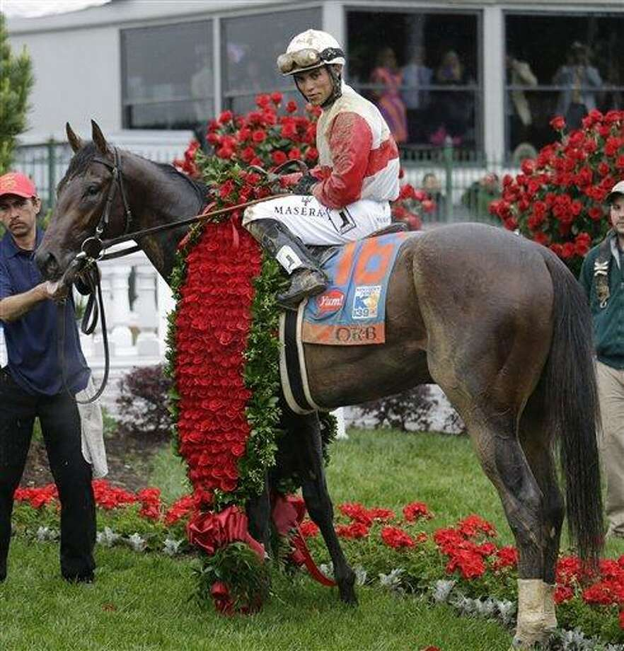 Joel Rosario sits on Orb in the winners circle after winning the 139th Kentucky Derby at Churchill Downs Saturday, May 4, 2013, in Louisville, Ky. (AP Photo/J. David Ake) Photo: AP / AP