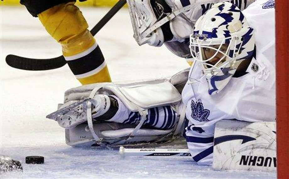 Toronto Maple Leafs goalie Ben Scrivens twists as he looks back at the puck before making a save against the Boston Bruins during the second period of an NHL hockey game in Boston, Thursday, March 7, 2013. (AP Photo/Charles Krupa) Photo: AP / AP
