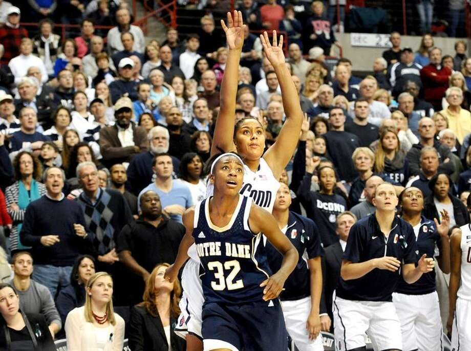 Connecticut's Kaleena Mosqueda-Lewis watches with Notre Dame's Jewell Loyd (32) her three-point shot attempt with six seconds left in an NCAA college basketball game against Notre Dame in Storrs, Conn., Saturday, Jan. 5, 2013.  Notre Dame got the rebound on Mosqueda-Lewis's missed shot and won 73-72. (AP Photo/Jessica Hill) Photo: AP / FR125654 AP
