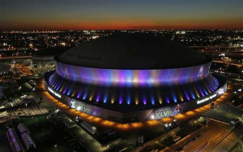 The Superdome, where the NFL Super Bowl XLVII football game between the San Francisco 49ers and Baltimore Ravens will be played, is seen at sunset Friday, Feb. 1, 2013, in New Orleans. (AP Photo/Charlie Riedel) Photo: AP / AP