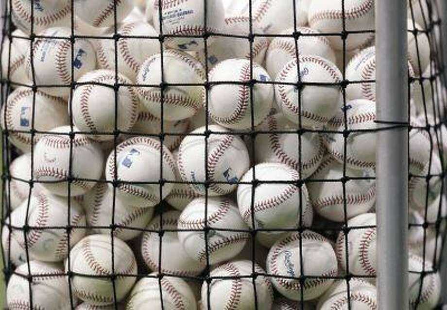 Batting practice baseballs are shown before a baseball game between the Tampa Bay Rays and the New York Yankees April 22, 2013, in St. Petersburg, Fla. Photo: AP / AP