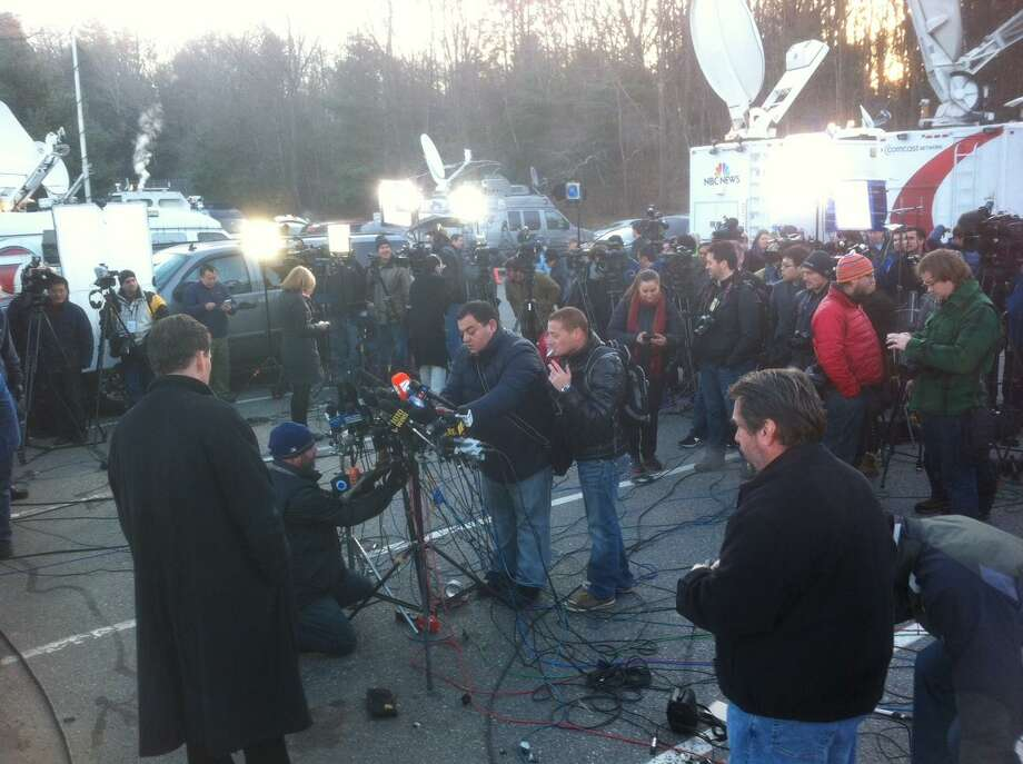 Press prepares for conference on Sandy Hook Elementary School tragedy. Peter Hvizdak/Register