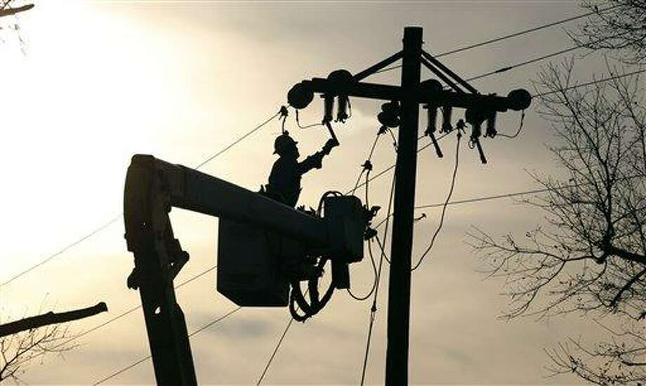 A Coast Electric Power Association lineman grounds a line on a replacement pole in McNeill, Miss., Wednesday, Dec. 26, 2012. The Christmas day storms downed both telephone and electric power lines and poles throughout the state in addition to extensive private property damage. More than 25 people were injured and at least 70 homes were damaged in Mississippi by the severe storms that pushed across the South on Christmas Day, authorities said Wednesday. Damages have been reported in 10 counties and officials continue to assess the situation. (AP Photo/Rogelio V. Solis) Photo: AP / AP
