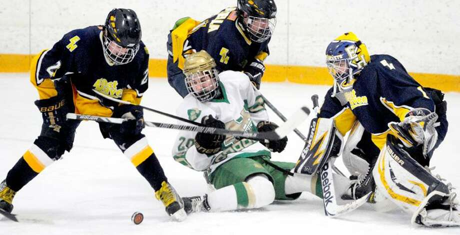 Kyle Lynch (center) of Notre Dame - West Haven tries to score against East Haven in the first period at Bennett Rink in West Haven on 3/6/2013.Photo by Arnold Gold/New Haven Register