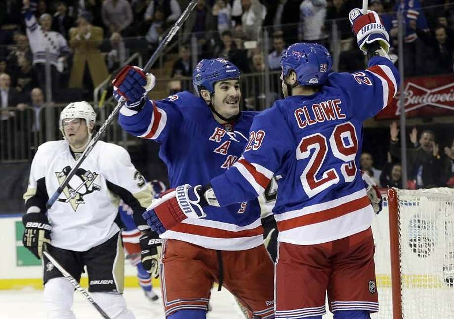 Pittsburgh Penguins' Douglas Murray (3) reacts as New York Rangers' Brian Boyle, center, hugs Ryane Clowe (29) after Clowe scored his second goal of the game during the first period of an NHL hockey game, Wednesday, April 3, 2013, in New York. (AP Photo/Frank Franklin II) Photo: AP / AP2013