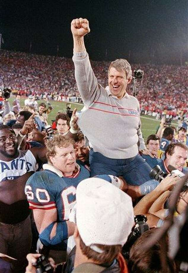 FILE - In this Jan. 25, 1987, file photo, New York Giants coach Bill Parcells is carried off the field after the Giants defeated the Denver Broncos 39-20 in SuperBowl XXI NFL football game in Pasadena, Calif. Parcells was selected to the Pro Football Hall of Fame on Saturday, Feb. 2, 2013. (AP Photo/Eric Risberg, File) Photo: AP / AP