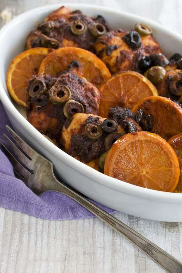 Matthew Mead/Associated Press photo: Honey-Paprika Chicken With Roasted Oranges Photo: AP / FR170582