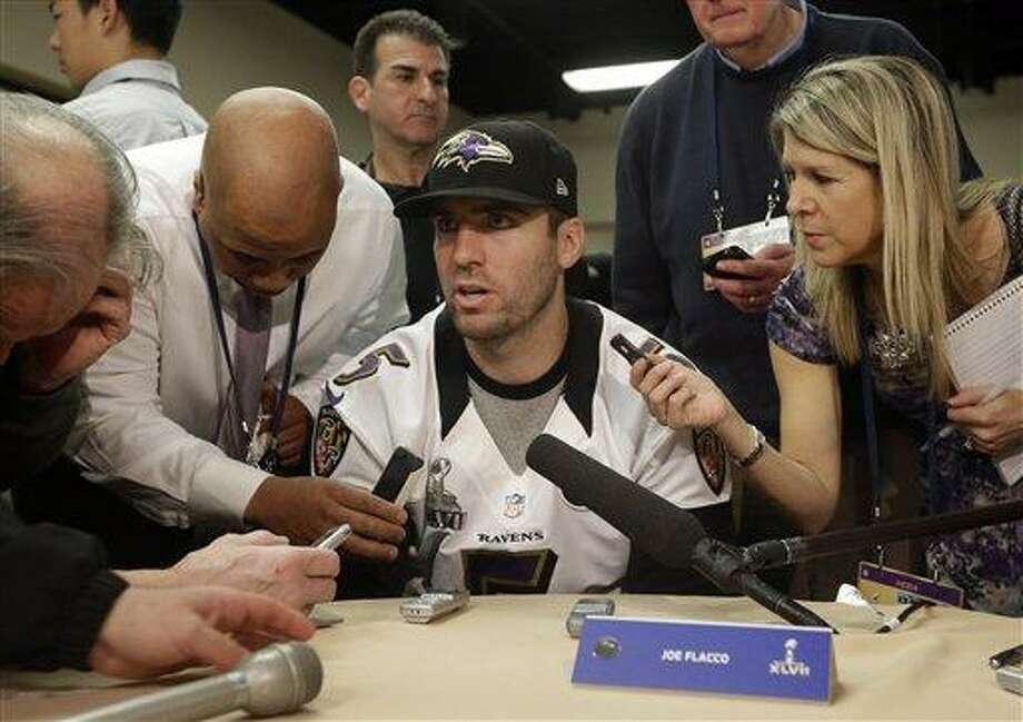 Baltimore Ravens quarterback Joe Flacco, center, speaks with reporters at an NFL Super Bowl XLVII football news conference on Wednesday, Jan. 30, 2013, in New Orleans. The Ravens face the San Francisco 49ers in Super Bowl XLVII on Sunday, Feb. 3. (AP Photo/Patrick Semansky) Photo: AP / AP