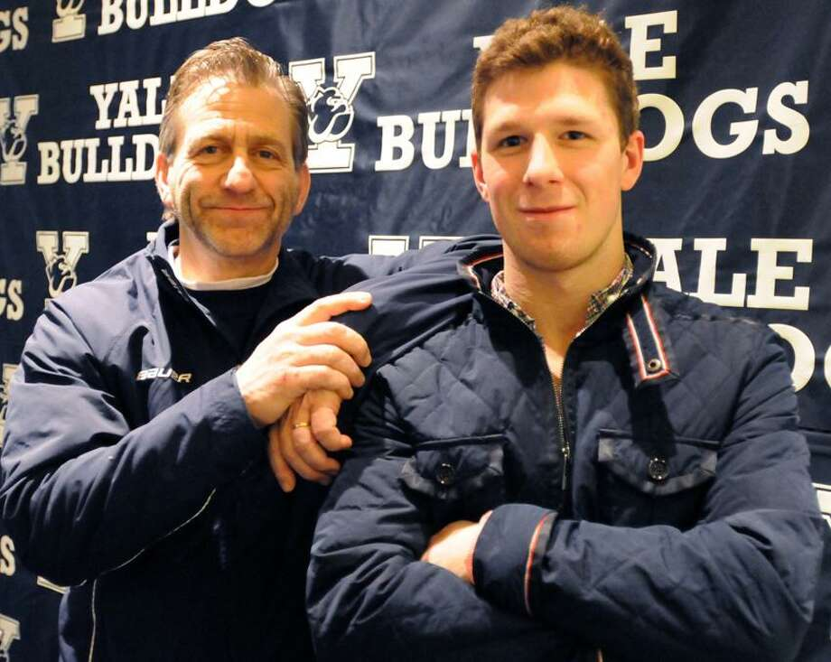 Yale University Hockey coach Keith Allain  and team captain Andrew Miller, right, after a press conference at Yale's Ingalls Rink Thursday, April 4, 2013. The Yale hockey team is traveling to the Frozen Four NCAA Hockey Championship in Pittsburg.  Photo by Peter Hvizdak / New Haven Register. Photo: New Haven Register / ©Peter Hvizdak /  New Haven Register