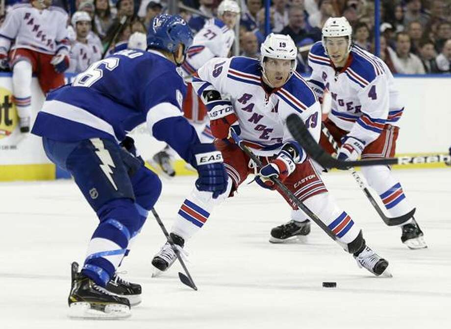 New York Rangers center Brad Richards (19) carries the puck towards Tampa Bay Lightning defenseman Sami Salo (6), of Finland, during the first period of an NHL hockey game Saturday, Feb. 2, 2013, in Tampa, Fla. Rangers' Michael Del Zotto (4) trails the play. (AP Photo/Chris O'Meara) Photo: AP / AP2013