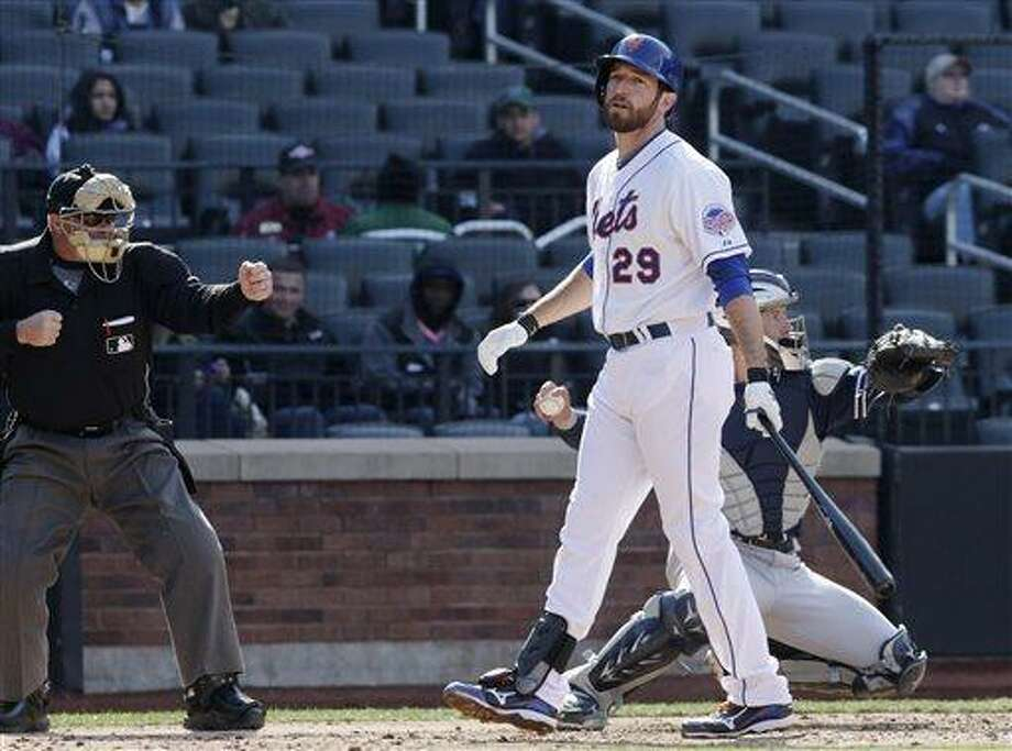 Home plate umpire Marvin Hudson calls out New York Mets' Ike Davis on strikes in the eighth inning of a baseball game against the San Diego Padres, Thursday, April 4, 2013 at Citi Field in New York. The Padres won 2-1. (AP Photo/Mark Lennihan) Photo: AP / AP