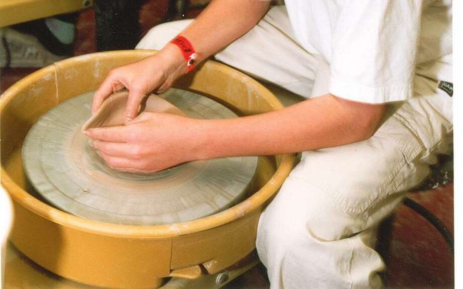 Contributed photo: A potter takes the wheel at the Guilford Art Center.
