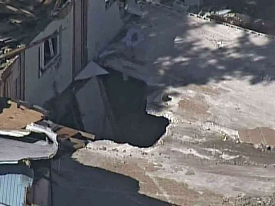 In this video image provided by ABC Action News-WFTS TV, shows an aerial photo of a sinkhole Monday, Mar. 4, 2013, in Seffner, Fla. The hole opened up underneath a bedroom late Thursday evening and swallowed Jeffrey Bush in Seffner, Fla. (AP Photo/ABC Action News-WFTS TV) Photo: ASSOCIATED PRESS / AP2013