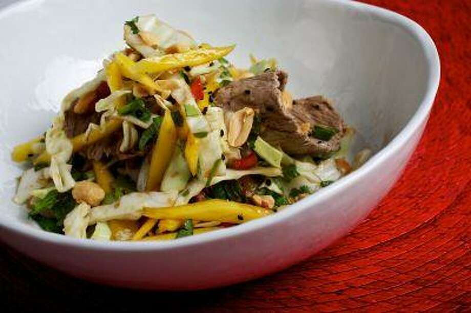 Lime Beef Salad. A chef's take on a crunchy, tangy, savory salad. (Deb Lindsey for The Washington Post; tableware from Crate and Barrel) Photo: The Washington Post / WASHINGTON POST