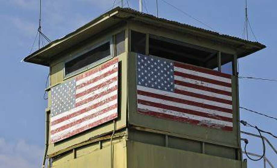 A U.S. Marine guard tower overlooks the Northeast gate leading into Cuba territory at Guantanamo Bay U.S. Naval Base, March 8, 2013. Photo: REUTERS / X01138