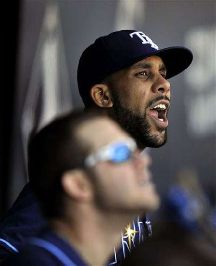Tampa Bay Rays starting pitcher David Price yells in the dugout after exchanging words with home plate umpire Tom Hallion during the seventh inning of a game against the Chicago White Sox in Chicago, April 28, 2013. Photo: ASSOCIATED PRESS / AP2013