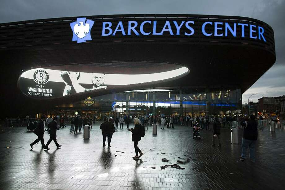 FILE - This Oct. 15, 2012 file photo shows spectators arriving at the Barclays Center for a preseason NBA basketball game between the Brooklyn Nets and the Washington Wizards. (AP Photo/John Minchillo, File) Photo: AP / A2012
