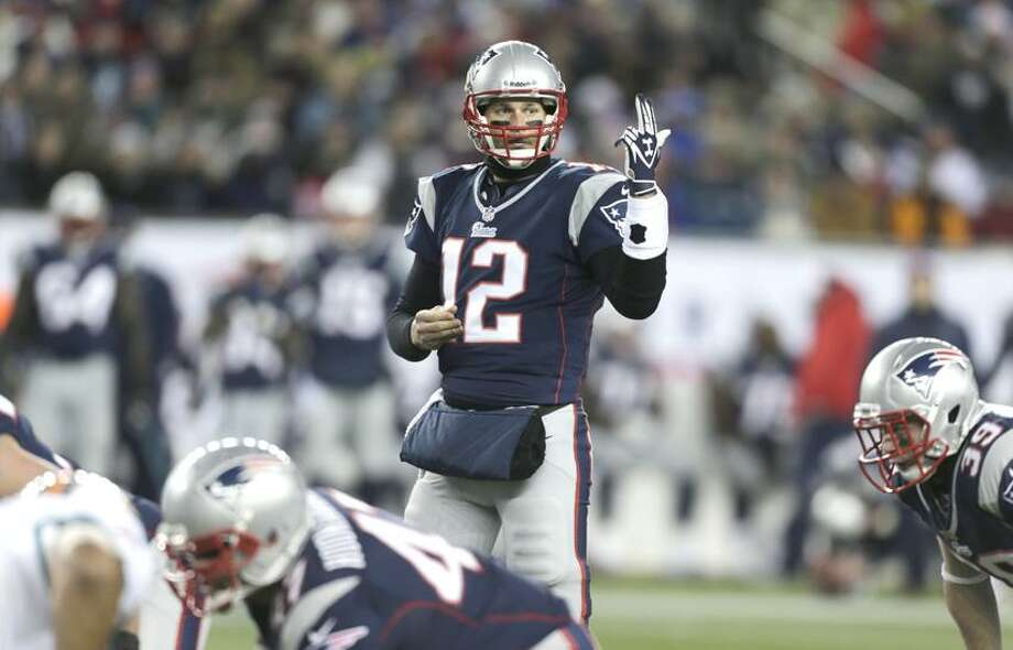 New England Patriots quarterback Tom Brady  makes a call against the Miami Dolphins during the second quarter of an NFL football game in Foxborough, Mass., Sunday, Dec. 30, 2012. (AP Photo/Charles Krupa) Photo: AP / AP2012